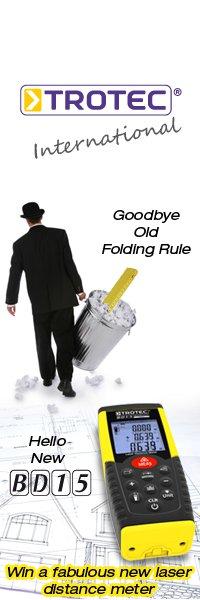 Man in a bowler hat carrying a folding rule in a bin