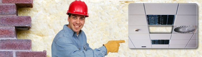 left part of brick wall middle smiling builder pointing at device right